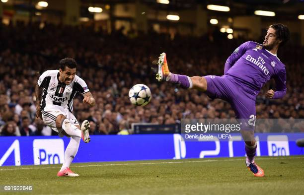Dani Alves of Juventus attempts to cross as Isco of Real Madrid attempts to block during the UEFA Champions League Final between Juventus and Real...