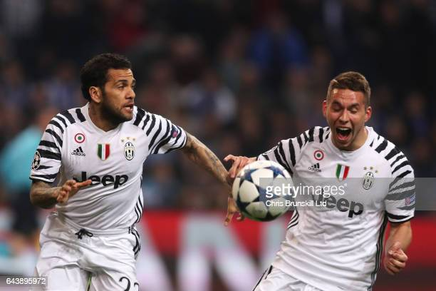 Dani Alves of Juventus celebrates scoring the second goal to make the score 02 with Marko Pjaca during the UEFA Champions League Round of 16 first...