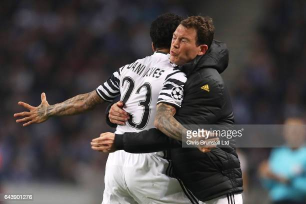 Dani Alves of Juventus celebrates scoring the second goal to make the score 02 with Stephan Lichtsteiner during the UEFA Champions League Round of 16...
