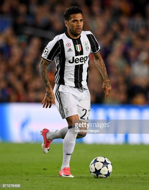 Dani Alves of Juventus controls the ball during the UEFA Champions League Quarter Final second leg match between FC Barcelona and Juventus at Camp...