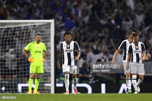 Dani Alves of Juventus looks dejected during the UEFA Champions League Final between Juventus and Real Madrid at National Stadium of Wales on June 3...