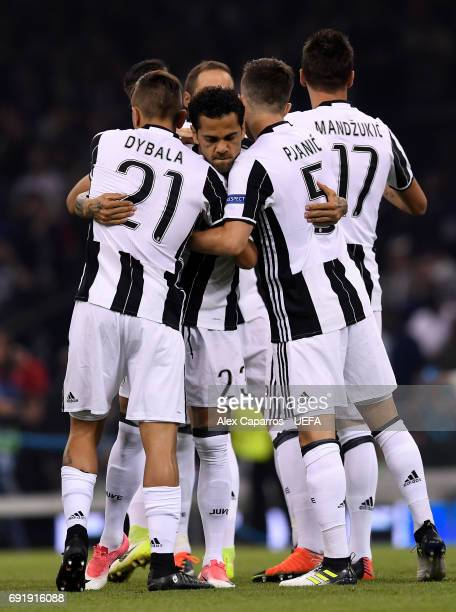 Dani Alves of Juventus Paulo Dybala of Juventus and Miralem Pjanic of Juventus embrace prior to the UEFA Champions League Final between Juventus and...