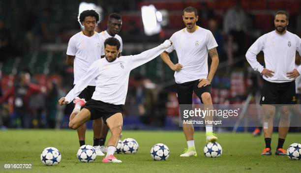 Dani Alves of Juventus shoots during a Juventus training session prior to the UEFA Champions League Final between Juventus and Real Madrid at the...