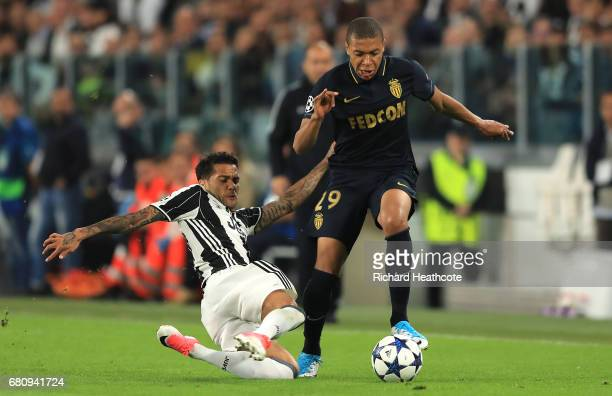 Dani Alves of Juventus tackles Kylian Mbappe of AS Monaco during the UEFA Champions League Semi Final second leg match between Juventus and AS Monaco...