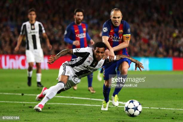 Dani Alves of Juventus tangles with Andres Iniesta of FC Barcelona during the UEFA Champions League Quarter Final second leg match between FC...