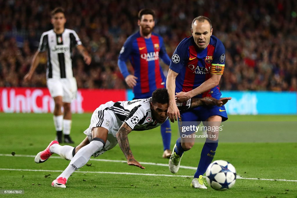 Dani Alves of Juventus tangles with Andres Iniesta of FC Barcelona during the UEFA Champions League Quarter Final second leg match between FC Barcelona and Juventus at Camp Nou on April 19, 2017 in Barcelona, Spain.