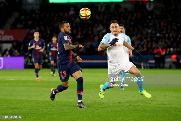 Dani Alves of Paris Saint Germain and Lucas Ocampos of Olympique de Marseille during the Ligue 1 match between Paris Saint Germain and Marseille at...