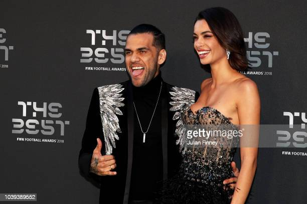 Dani Alves of Paris SaintGermain and Joana Sanz arrive on the Green Carpet ahead of The Best FIFA Football Awards at Royal Festival Hall on September...