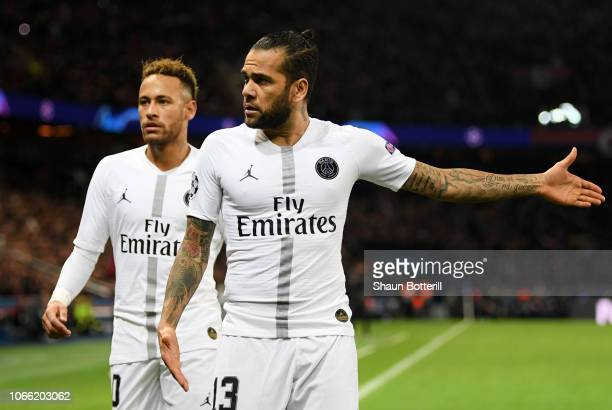 Dani Alves of Paris SaintGermain and Neymar of Paris SaintGermain look on during the UEFA Champions League Group C match between Paris SaintGermain...