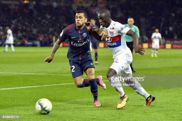 Dani Alves of Paris SaintGermain and Tanguy Ndombele of Olympique Lyonnais fight for the ball during the Ligue 1 match between Paris Saint Germain...
