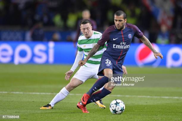 Dani Alves of Paris SaintGermain and Tom Rogic of Celtic Glasgow fight for the ball during the UEFA Champions League group B match between Paris...