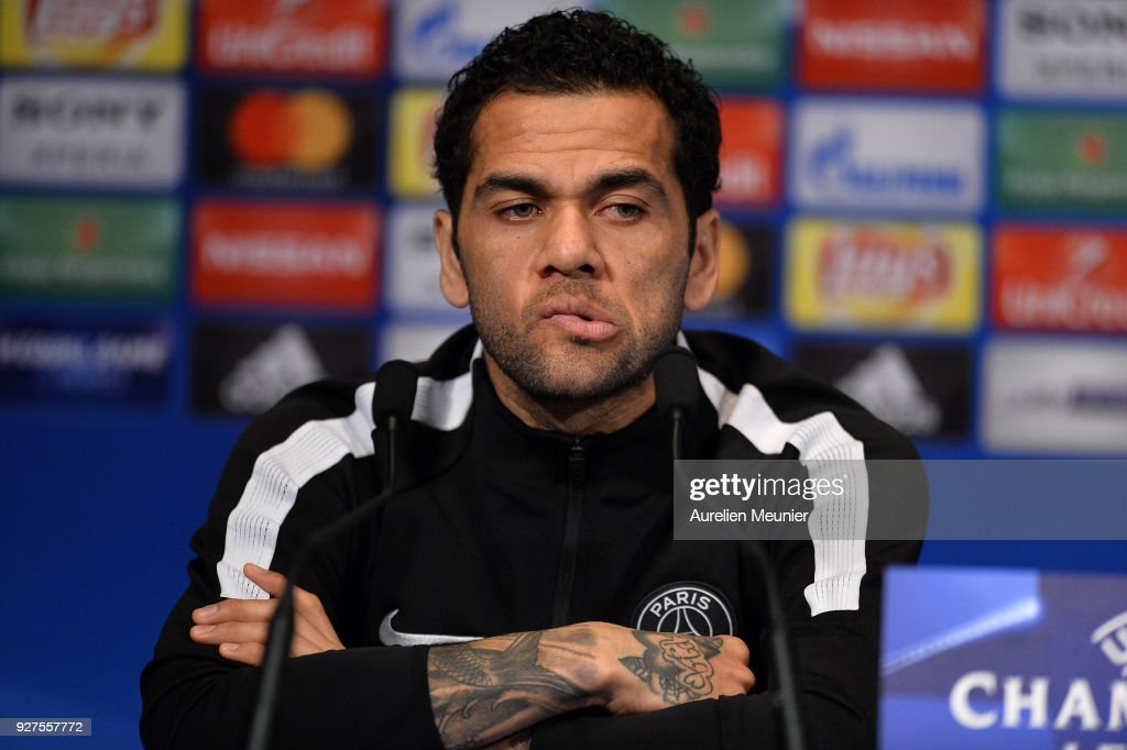 Dani Alves of Paris Saint-Germain answers journalists during a press conference before the Champion's League match against Real Madrid at Parc des Princes on March 5, 2018 in Paris.