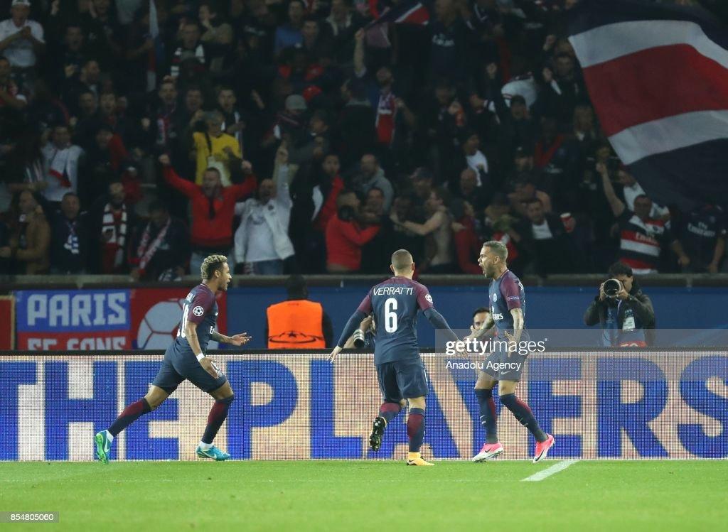 Dani Alves (R) of Paris Saint-Germain celebrates his score with Neymar (L) during the UEFA Champions League Group B match between Paris Saint-Germain (PSG) and Bayern Munich at Parc des Princes Stadium in Paris, France on September 27, 2017.
