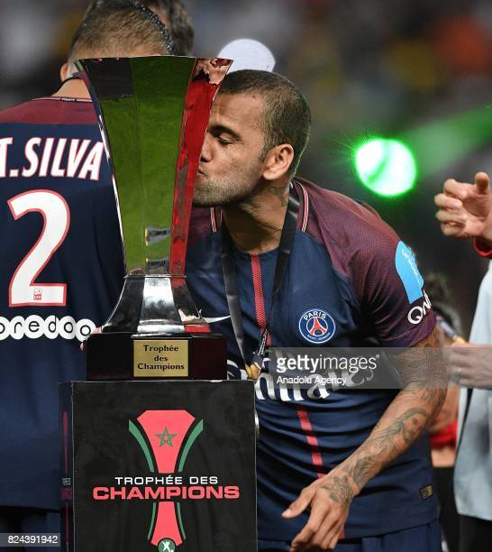 Dani Alves of Paris SaintGermain kisses the trophy as he celebrates with teammates after winning the French Trophy of Champions football match...