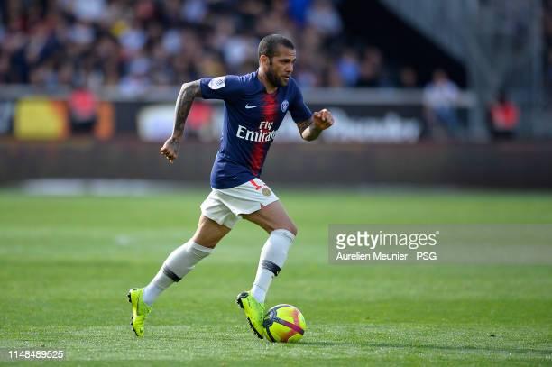 Dani Alves of Paris SaintGermain runs with the ball during the Ligue 1 match between Paris SaintGermain and Angers SCO at Stade Raymond Kopa on May...