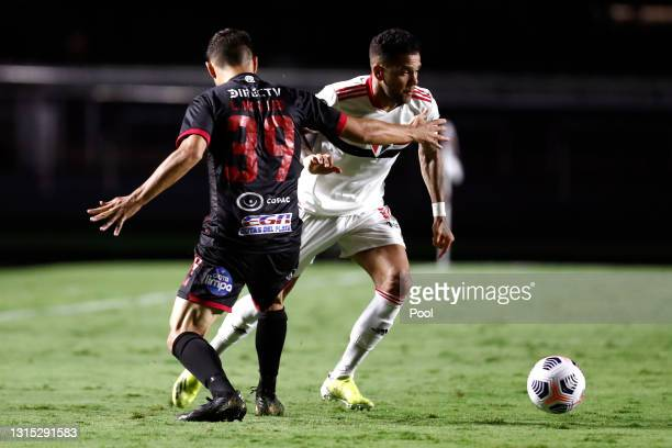 Dani Alves of Sao Paulo against Lucas Morales of Rentistas during a match between Sao Paulo and Rentistas as part of Group E of Copa CONMEBOL...