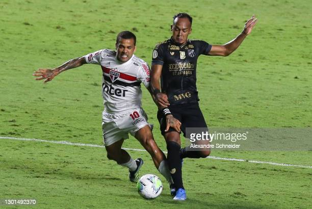 Dani Alves of Sao Paulo and Bruno Pacheco of Ceara fight for the ball during a match between Sao Paulo and Ceara as part of Brasileirao Series A 2020...