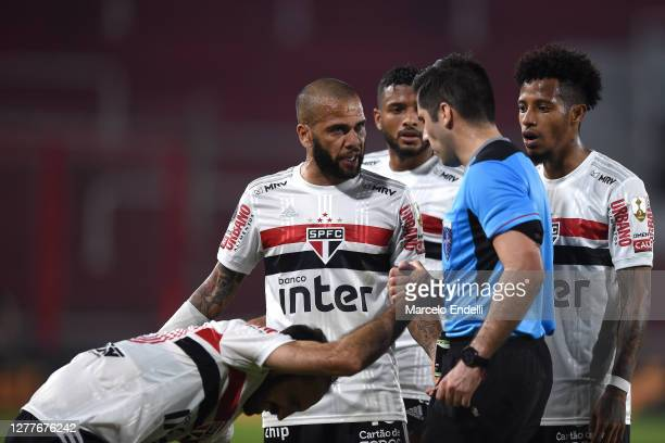 Dani Alves of Sao Paulo argues with referee Cristián Garay during a Copa CONMEBOL Libertadores 2020 group D match between River Plate and Sao Paulo...
