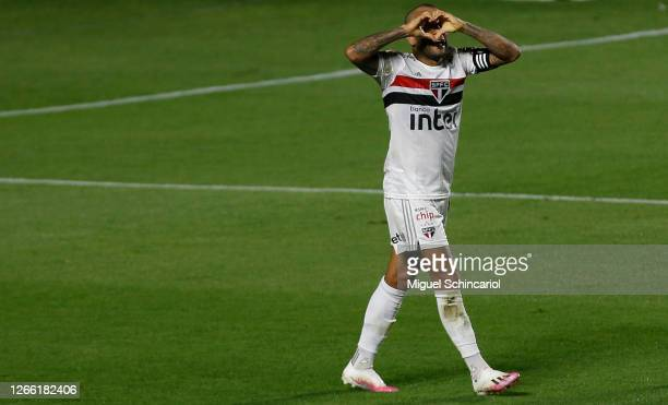 Dani Alves of Sao Paulo celebrates after scoring his team first goal during a match between Sao Paulo and Fortaleza as part of Brasileirao Series A...