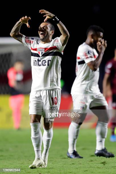 Dani Alves of Sao Paulo celebrates after scoring the first goal of his team during a second leg match of Copa CONMEBOL Sudamericana second round...