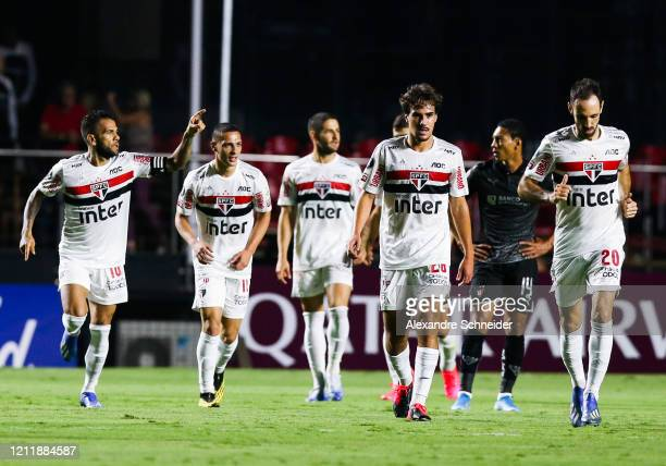 Dani Alves of Sao Paulo celebrates with his teammates after scoring the second goal of hi team during the match against LDU for the Copa CONMEBOL...