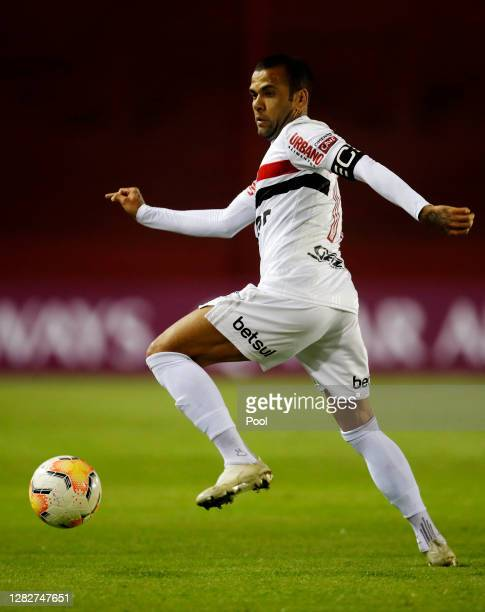 Dani Alves of Sao Paulo controls the ball during a second round match of Copa CONMEBOL Sudamericana 2020 between Lanus and Sao Paulo at Estadio...