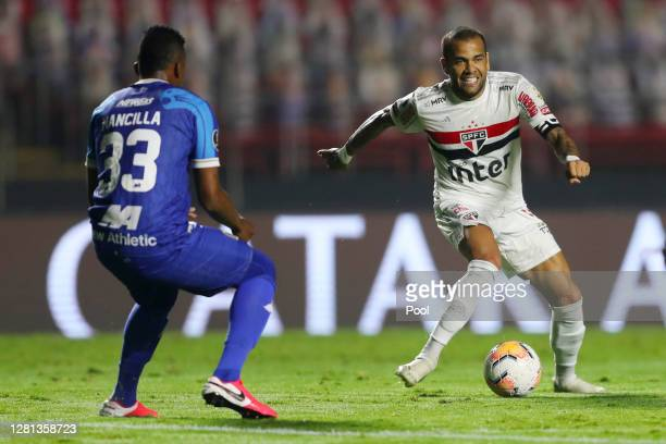 Dani Alves of Sao Paulo fights for the ball with Camilo Mancilla of Binacional during a Group D Match of Copa CONMEBOL Libertadores 2020 between Sao...