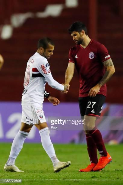 Dani Alves of Sao Paulo greets Nicolás Orsini of Lanus at the end of a second round match of Copa CONMEBOL Sudamericana 2020 between Lanus and Sao...