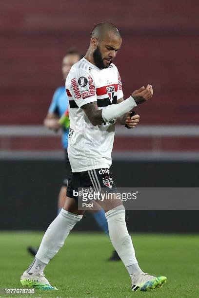 Dani Alves of Sao Paulo leaves the field after losing a Copa CONMEBOL Libertadores 2020 group D match between River Plate and Sao Paulo at Estadio...
