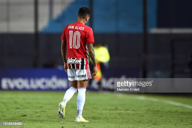 Dani Alves of Sao Paulo leaves the pitch after suffering an injury during a match between Racing Club and Sao Paulo as part of Group E of Copa...