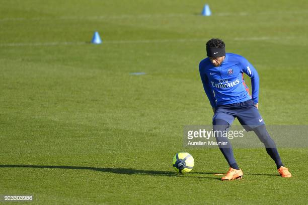 Dani Alves warms up during a Paris SaintGermain training session at Centre Ooredoo on February 23 2018 in Paris France