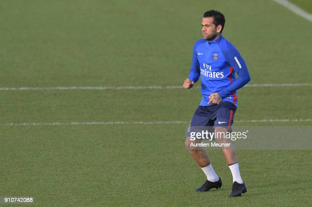 Dani Alves warms up during a training session of Paris Saint Germain PSG at Camp des Loges on January 26 2018 in Paris France