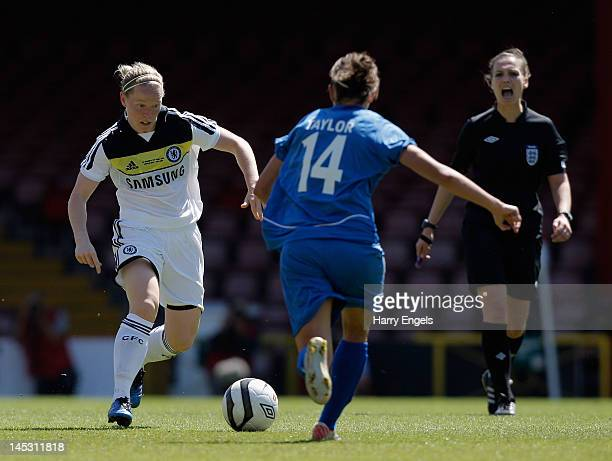 Dani Buet of Chelsea runs with the ball as referee Natalie Walker looks on during the FA Women's Cup Final between Birmingham City Ladies FC and...
