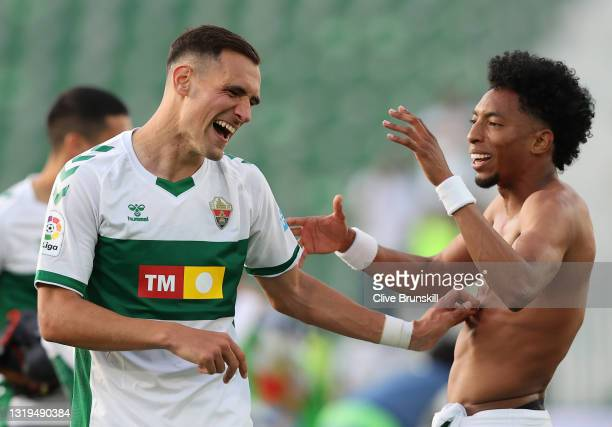 Dani Calvo of Elche CF celebrates with Johan Mojica of Elche CF on full time as their team successfully avoids relegation during the La Liga...