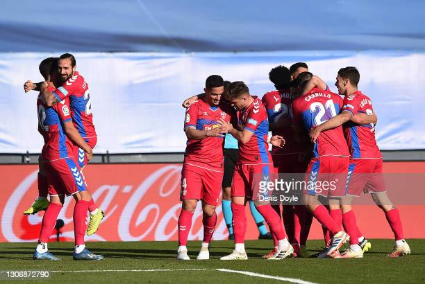 Dani Calvo of Elche CF celebrates with teammates after scoring his team's first goal during the La Liga Santander match between Real Madrid and Elche...