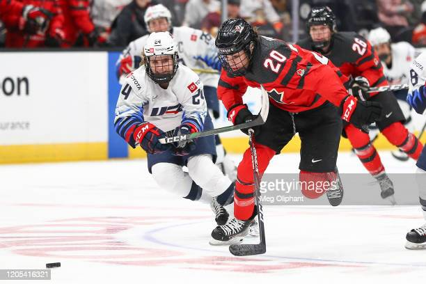 Dani Cameranesi of the U.S. Women's Hockey Team and Sarah Nurse of the Canadian Women's National Team go for the puck in the third period at Honda...