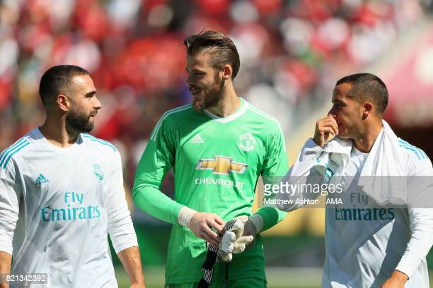 Dani Carvajal and Lucas Vazquez of Real Madrid chat to David de Gea of Manchester United during the International Champions Cup 2017 match between...