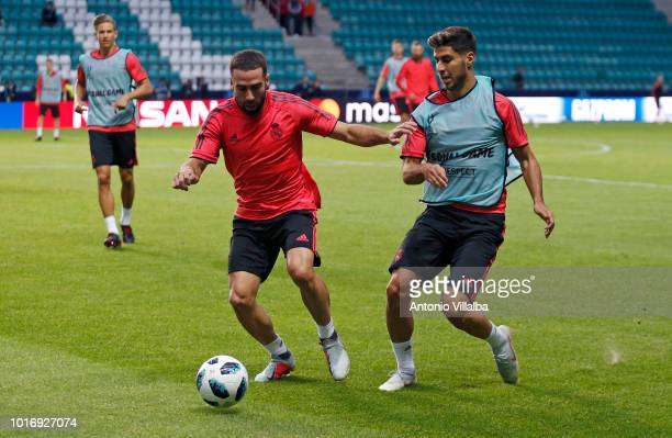 Dani Carvajal and Marco Asensio of Real Madrid during a training session at A Le Coq Arena on August 14 2018 in Tallinn Estonia
