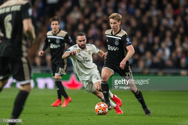 Dani Carvajal of Real Madrid and Frenkie de Jong of Ajax battle for the ball during the UEFA Champions League Round of 16 Second Leg match between...