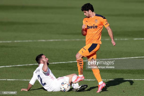 Dani Carvajal of Real Madrid and Goncalo Guedes of Valencia CF battle for possession during the La Liga Santander match between Real Madrid and...