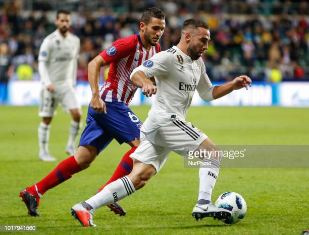 Dani Carvajal of Real Madrid and Koke of Atletico Madrid vie for the ball during the UEFA Super Cup match between Real Madrid and Atletico Madrid on...