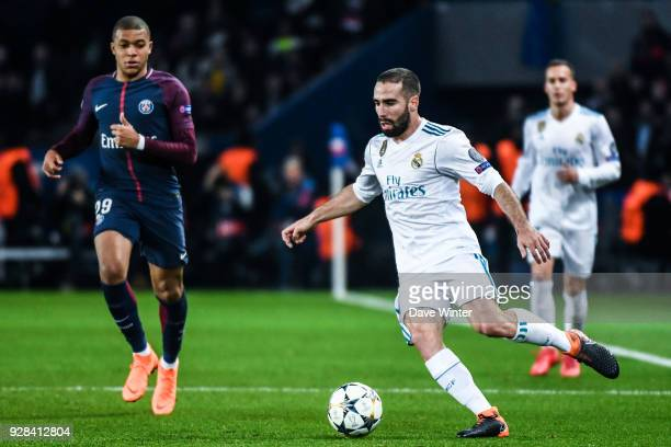 Dani Carvajal of Real Madrid and Kylian Mbappe of PSG during the UEFA Champions League Round of 16 Second Leg match between Paris Saint Germain and...