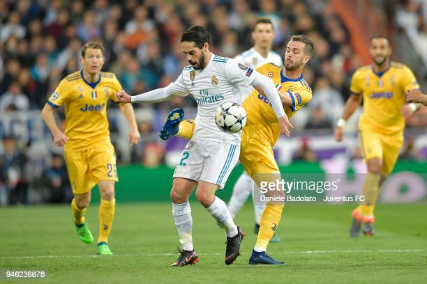 Dani Carvajal of real Madrid and Miralem Pjanic of Juventus in action during the Champions League match between Real Madrid and Juventus at Estadio...