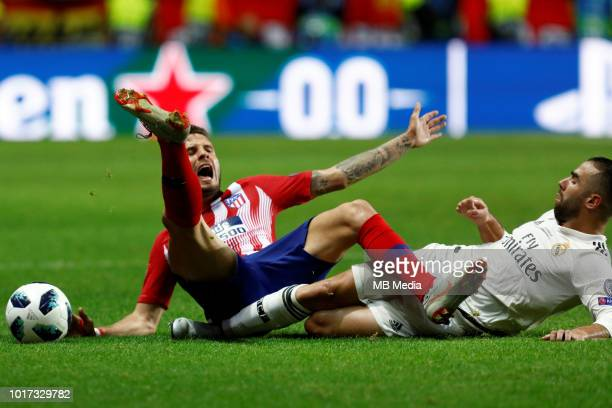 Dani Carvajal of Real Madrid and Saul of Atletico Madrid collide as they vie for the ball during the UEFA Super Cup match between Real Madrid and...
