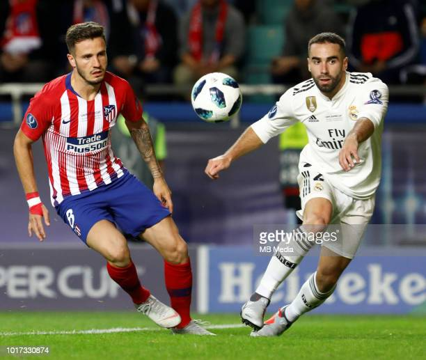 Dani Carvajal of Real Madrid and Saul of Atletico Madrid compete for the ball during the UEFA Super Cup match between Real Madrid and Atletico Madrid...
