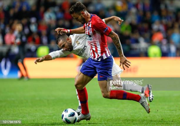 Dani Carvajal of Real Madrid and Saul of Atletico Madrid vie for the ball during the UEFA Super Cup match between Real Madrid and Atletico Madrid on...