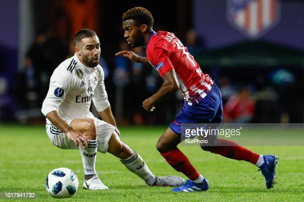 Dani Carvajal of Real Madrid and Thomas Lemar of Atletico Madrid vie for the ball during the UEFA Super Cup match between Real Madrid and Atletico...