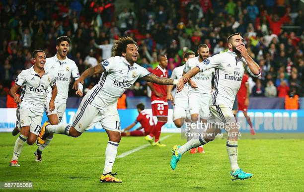 Dani Carvajal of Real Madrid celebrates scoring his team's third goal with Marcelo during the UEFA Super Cup match between Real Madrid and Sevilla at...