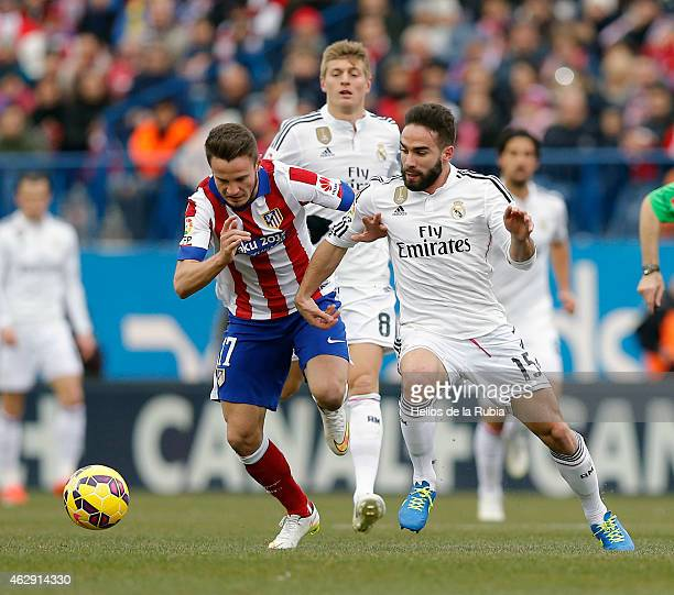 Dani Carvajal of Real Madrid cf and Saul of Atletico de Madrid cf compete fir the ball during the La Liga mach between Club Atletico de Madrid and...