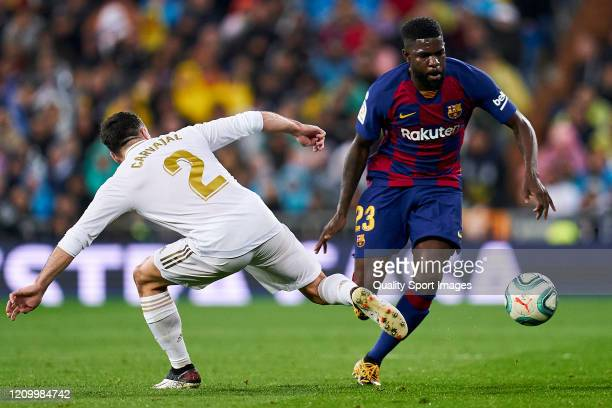 Dani Carvajal of Real Madrid CF battle for the ball with Samuel Umtiti of FC Barcelona during the Liga match between Real Madrid CF and FC Barcelona...